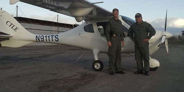 Photo shows Deputy Scott Ballantyne, left, and pilot James Chavez in front of the Tulare County Sheriff's Office plane.