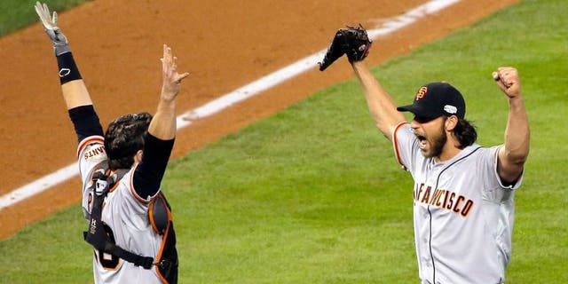 KANSAS CITY, MO - OCTOBER 29: Buster Posey #28 and Madison Bumgarner #40 of the San Francisco Giants celebrate after defeating the Kansas City Royals to win Game Seven of the 2014 World Series by a score of 3-2 at Kauffman Stadium on October 29, 2014 in Kansas City, Missouri. (Photo by Doug Pensinger/Getty Images)