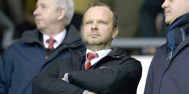 Manchester United's executive vice-chairman Ed Woodward (C) stands in the crowd ahead of the FA cup fourth round football match between Derby County and Manchester United at Pride Park stadium in Derby on January 29, 2016. / AFP / OLI SCARFF / RESTRICTED TO EDITORIAL USE. No use with unauthorized audio, video, data, fixture lists, club/league logos or 'live' services. Online in-match use limited to 75 images, no video emulation. No use in betting, games or single club/league/player publications. / (Photo credit should read OLI SCARFF/AFP/Getty Images)