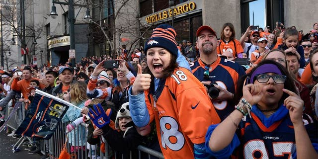 DENVER, CO - FEBRUARY 9: Broncos fans cheer as the players pass by on firetrucks. The city of Denver held a victory parade for the Denver Broncos, Super Bowl 50 champions, on Tuesday, February 9, 2016. (Photo by Joe Amon/The Denver Post via Getty Images)
