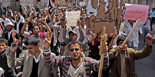 Feb. 12: Yemeni anti-government demonstrators chant slogans and hold banners during a demonstration celebrating the resignation of Egyptian leader Hosni Mubarak and demanding the ouster of their own president, in Sanaa, Yemen.
