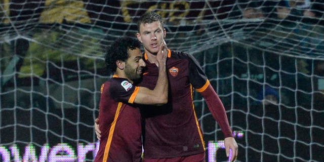 MODENA, ITALY - FEBRUARY 12: Edin Dzeko of AS Roma celebrate after scoring his team's second goal during the Serie A match between Carpi FC and AS Roma at Alberto Braglia Stadium on February 12, 2016 in Modena, Italy. (Photo by Dino Panato/Getty Images)