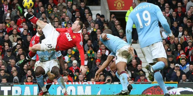 MANCHESTER, ENGLAND - FEBRUARY 12: Wayne Rooney of Manchester United scores their second goal during the Barclays Premier League match between Manchester United and Manchester City at Old Trafford on February 12, 2011 in Manchester, England. (Photo by Matthew Peters/Man Utd via Getty Images) *** Local Caption *** Wayne Rooney