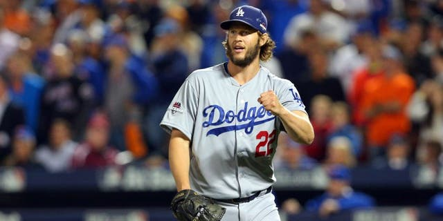 Oct 13, 2015; New York City, NY, USA; Los Angeles Dodgers starting pitcher Clayton Kershaw (22) reacts after the seventh inning against the New York Mets in game four of the NLDS at Citi Field. Mandatory Credit: Brad Penner-USA TODAY Sports