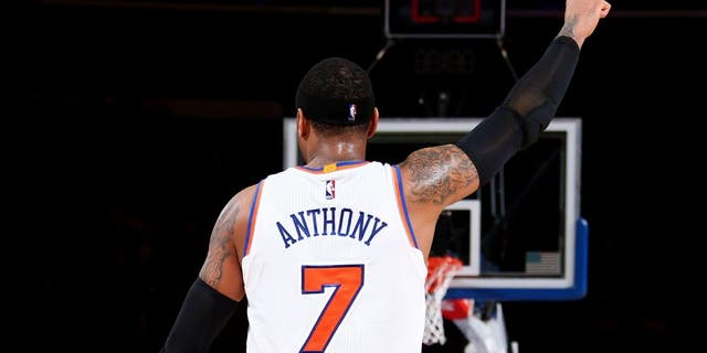 NEW YORK, NY - FEBRUARY 9: Carmelo Anthony #7 of the New York Knicks reacts to a play against the Washington Wizards on February 9, 2016 at Madison Square Garden in New York City, New York. NOTE TO USER: User expressly acknowledges and agrees that, by downloading and or using this photograph, User is consenting to the terms and conditions of the Getty Images License Agreement. Mandatory Copyright Notice: Copyright 2016 NBAE (Photo by Nathaniel S. Butler/NBAE via Getty Images)