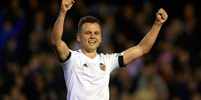 VALENCIA, SPAIN - FEBRUARY 13: Denis Cheryshev of Valencia celebrates scoring his team's second goal during the La Liga match between Valencia CF and RCD Espanyol at Estadi de Mestalla on February 13, 2016 in Valencia, Spain. (Photo by Manuel Queimadelos Alonso/Getty Images)