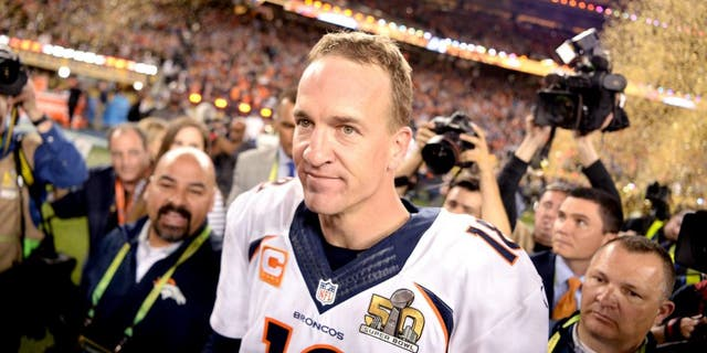 SANTA CLARA, CA - FEBRUARY 07: Peyton Manning (18) of the Denver Broncos walks through the crowd as the confetti flies after the Broncos win. The Denver Broncos played the Carolina Panthers in Super Bowl 50 at Levi's Stadium in Santa Clara, Calif. on February 7, 2016. (Photo by AAron Ontiveroz/The Denver Post via Getty Images)