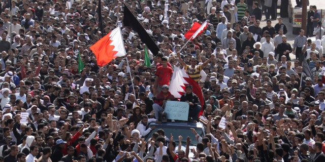 Feb. 15: A funeral procession for Ali Abdulhadi Mushaima, 21, moves slowly through the streets of Jidhafs, Bahrain.