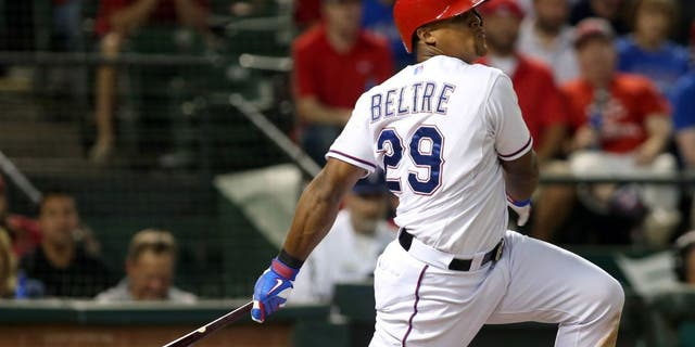 The Texas Rangers' Adrian Beltre singles in the seventh inning against the Los Angeles Angels at Globe Life Park in Arlington, Texas, on Thursday, Oct. 1, 2015. The Rangers won, 5-3. (Richard W. Rodriguez/Fort Worth Star-Telegram/TNS via Getty Images)