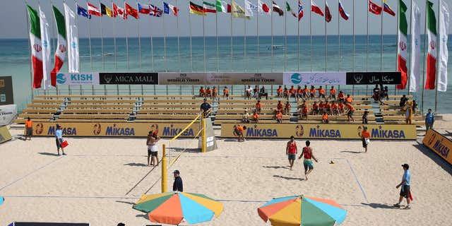 This picture made available by Tasnim News Agency and taken on Monday, Feb. 15, 2016, shows a volleyball match between Iran and Turkey during Beach Volleyball World Tour in the Iranian Kish island in the Persian Gulf.