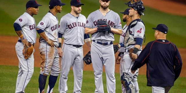 Sep 23, 2015; Minneapolis, MN, USA; Cleveland Indians shortstop Jose Ramirez (11) and shortstop Francisco Lindor (12) and second baseman Jason Kipnis (22) and first baseman Carlos Santana (41) and catcher Yan Gomes (10) wait with starting pitcher Corey Kluber (28) as manager Terry Francona comes to remove him from the game with the Minnesota Twins in the fourth inning at Target Field. Mandatory Credit: Bruce Kluckhohn-USA TODAY Sports