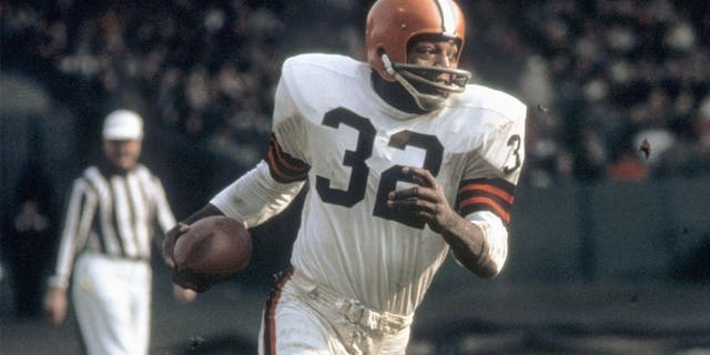 Running back Jim Brown #32 of the Cleveland Browns runs with the ball during a game in the 1960's at Municipal Stadium in Cleveland, Ohio. (Photo by: Tony Tomsic/Getty Images)