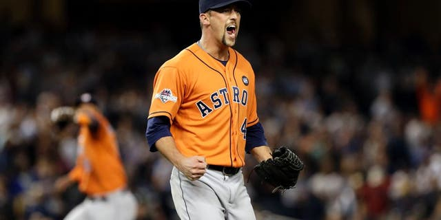 Oct 6, 2015; Bronx, NY, USA; Houston Astros relief pitcher Luke Gregerson (44) reacts after closing out the ninth inning against the New York Yankees in the American League Wild Card playoff baseball game at Yankee Stadium. Houston won 3-0. Mandatory Credit: Adam Hunger-USA TODAY Sports