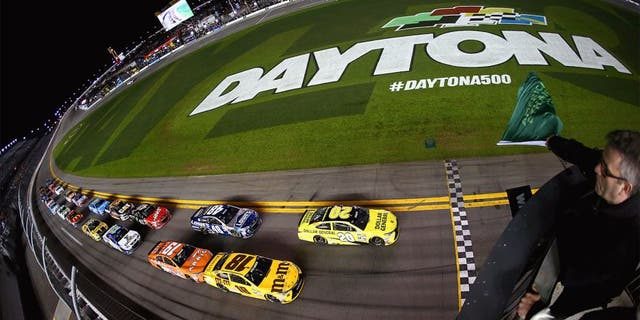 DAYTONA BEACH, FL - FEBRUARY 18: Matt Kenseth, driver of the #20 Dollar General Toyota, leads the field to the green flag to start the NASCAR Sprint Cup Series Can-Am Duels at Daytona International Speedway on February 18, 2016 in Daytona Beach, Florida. (Photo by Sarah Crabill/NASCAR via Getty Images)