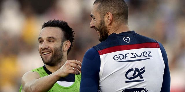 France's midfielder Mathieu Valbuena (L) talks to France's forward Karim Benzema during a training session at the Santa Cruz Stadium in Ribeirao Prato on June 10, 2014, a few days prior to the start of the 2014 FIFA World Cup in Brazil. AFP PHOTO / FRANCK FIFE (Photo credit should read FRANCK FIFE/AFP/Getty Images)