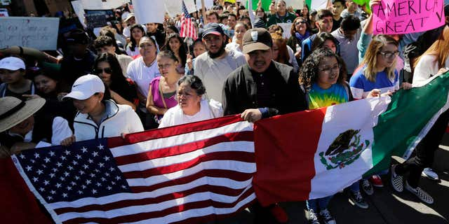 A group marches through downtown heading to the Texas Capitol during an immigration protest, Thursday, Feb. 16, 2017, in Austin, Texas.