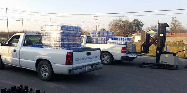 Crystal City officials delivering water to residents.
