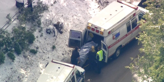 Feb. 21: An injured victim from a school bus accident is loaded into the back of an ambulance.