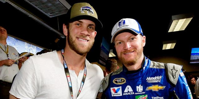 DAYTONA BEACH, FL - FEBRUARY 21: Bryce Harper poses with Dale Earnhardt Jr., driver of the #88 Nationwide Chevrolet at the driver's meeting prior to the NASCAR Sprint Cup Series DAYTONA 500 at Daytona International Speedway on February 21, 2016 in Daytona Beach, Florida. (Photo by Chris Trotman/NASCAR via Getty Images)