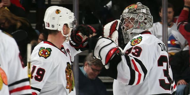 NEWARK, NJ - DECEMBER 09: Jonathan Toews #19 and Scott Darling #33 of the Chicago Blackhawks celebrate a 3-2 shootout victory over the New Jersey Devils at the Prudential Center on December 9, 2014 in Newark, New Jersey. (Photo by Bruce Bennett/Getty Images)