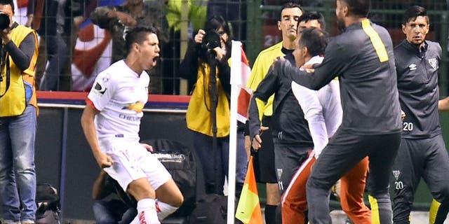 Ecuador's Liga de Quito Diego Morales (L) celebrates his goal against San Lorenzo during their Copa Libertadores football match at Casa Blanca stadium in Quito, on February 23, 2016. AFP PHOTO / RODRIGO BUENDIA / AFP / RODRIGO BUENDIA (Photo credit should read RODRIGO BUENDIA/AFP/Getty Images)