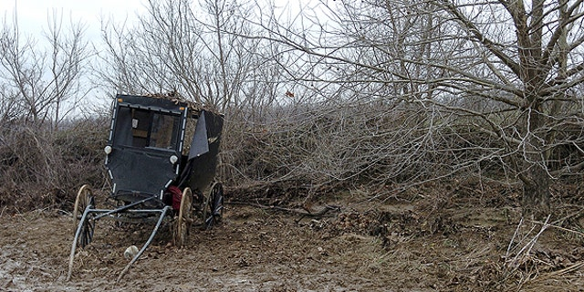 Feb. 25: The ravaged buggy of an Amish family is seen in a field along Roscoe Creek, in Hickman County near Dublin, Ky.