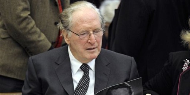 Jan. 22: Sen. Jay Rockefeller, D-W.Va., looks at the program prior to the start of the funeral Mass for R. Sargent Shriver at Our Lady of Mercy church in Potomac, Md.