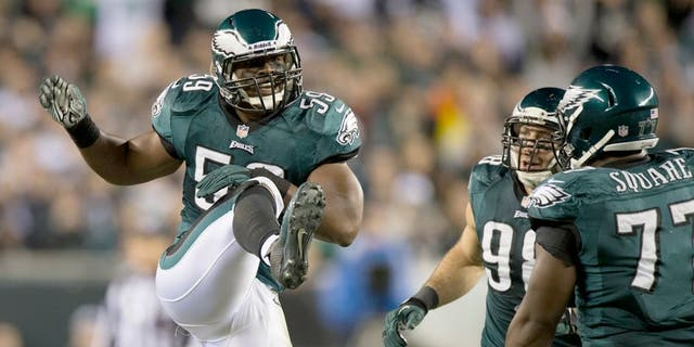 Dec 22, 2013; Philadelphia, PA, USA;Philadelphia Eagles inside linebacker DeMeco Ryans (59) celebrates after breaking up a pass during the third quarter at Lincoln Financial Field. Mandatory Credit: Tommy Gilligan-USA TODAY Sports