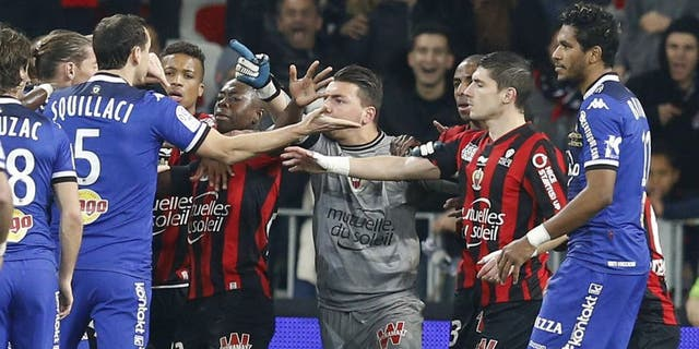 """Players of both teams clash during the French L1 football match Nice (OGC Nice) vs Bastia (SCB) on February 26, 2016 at the """"Allianz Riviera"""" stadium in Nice, southeastern France. AFP PHOTO / VALERY HACHE / AFP / VALERY HACHE (Photo credit should read VALERY HACHE/AFP/Getty Images)"""