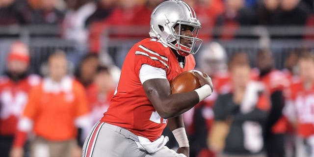 COLUMBUS, OH - NOVEMBER 7: Quarterback Cardale Jones #12 of the Ohio State Buckeyes runs with the ball against the Minnesota Golden Gophers at Ohio Stadium on November 7, 2015 in Columbus, Ohio. (Photo by Jamie Sabau/Getty Images)