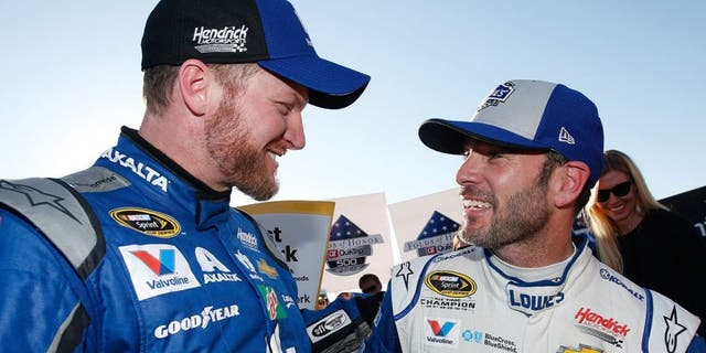 HAMPTON, GA - FEBRUARY 28: Jimmie Johnson, driver of the #48 Lowe's Chevrolet, celebrates with Dale Earnhardt Jr, driver of the #88 Nationwide Chevrolet, in Victory Lane after winning the NASCAR Sprint Cup Series Folds of Honor QuikTrip 500 at Atlanta Motor Speedway on February 28, 2016 in Hampton, Georgia. (Photo by Todd Warshaw/NASCAR via Getty Images)