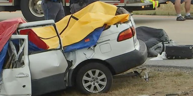 Tarps cover the extensive damages the car endured from the deadly crash, Friday, July 6, 2018.
