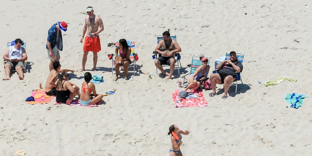After public New Jersey beaches were shuttered during the Fourth of July weekend due to a government shutdown, Gov. Chris Christie, R, was caught lounging on a private beach.
