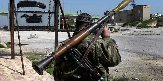 March 2, 2013: A Syrian fighter carries a shoulder-launched missile (AP/File)
