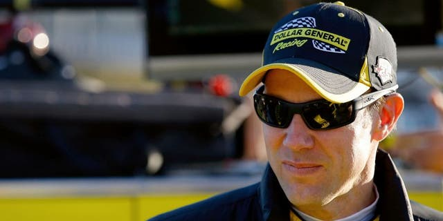 HAMPTON, GA - FEBRUARY 26: Matt Kenseth, driver of the #20 Dollar General Toyota, stands on the grid during qualifying for the NASCAR Sprint Cup Series Folds of Honor QuikTrip 500 at Atlanta Motor Speedway on February 26, 2016 in Hampton, Georgia. (Photo by Kevin C. Cox/Getty Images)