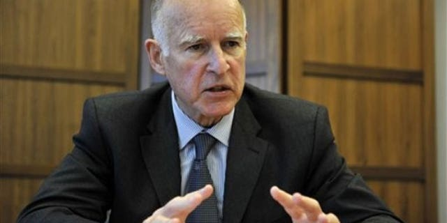 In this photo taken Dec. 24, 2009, Jerry Brown reflects on his tenure as Attorney General in his office in Oakland, Calif. (AP).