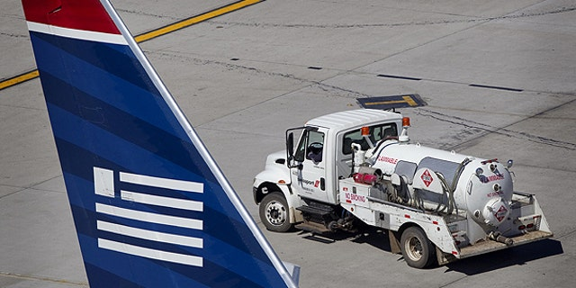 March 2: A fuel truck backs into position in preparation to refuel an airliner t Sky Harbor International Airport in Phoenix.