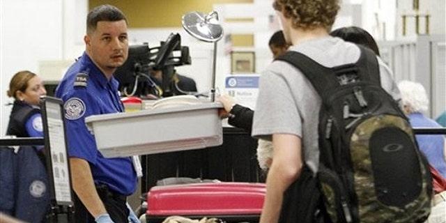 Dec. 23, 2010: A TSA officer checks passengers personal belongings at the X-ray machine at Miami International Airport in Miami.