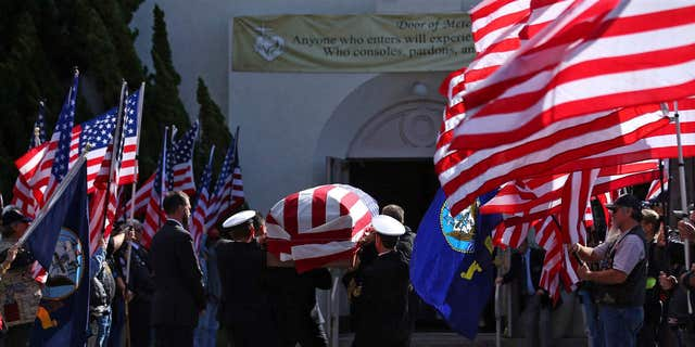 Nov. 1, 2016: The funeral begins for Coronado-based Chief Petty Officer Jason C. Finan, 34, of Anaheim, as his casket is carried into church in Coronado, Calif.
