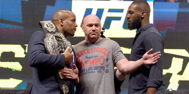 LAS VEGAS, NV - MARCH 04: (L-R) Opponents Daniel Cormier and Jon Jones face off during the UFC Unstoppable launch press conference at the MGM Grand Garden Arena on March 4, 2016 in Henderson, Nevada. (Photo by Josh Hedges/Zuffa LLC/Zuffa LLC via Getty Images)