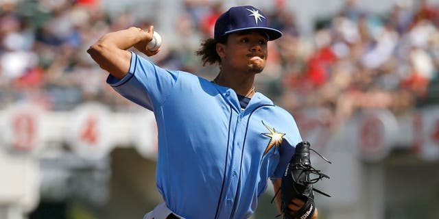 Tampa Bay Rays starting pitcher Chris Archer throws to the Boston Red Sox in the first inning of a spring training baseball game in Fort Myers, Fla., Friday, March 4, 2016. (AP Photo/Patrick Semansky)