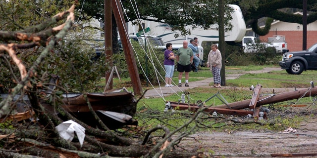 March 5: Residents look at damage from a suspected tornado that injured at least nine people, leveling homes and causing natural gas leaks that prompted evacuations in Rayne, La.