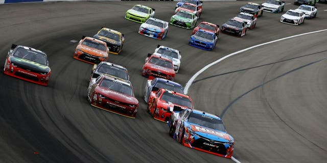 LAS VEGAS, NV - MARCH 05: Kyle Busch, driver of the #18 NOS Energy Drink Toyota, leads the field during the NASCAR Xfinity Series Boyd Gaming 300 at Las Vegas Motor Speedway on March 5, 2016 in Las Vegas, Nevada. (Photo by Sean Gardner/NASCAR via Getty Images)