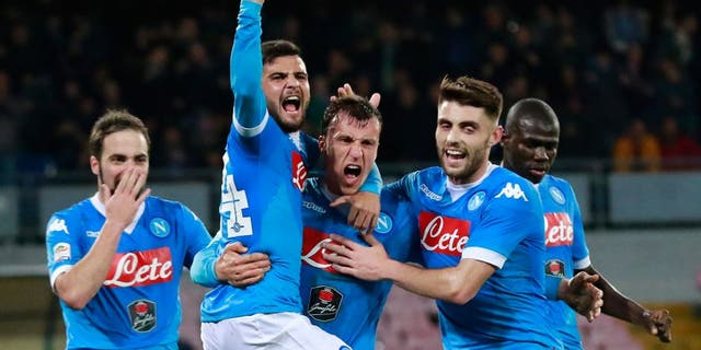 Napoli's Romanian defender Vlad Chiriches (C) celebrates with teammates after scoring a goal during the Italian Serie A football match between SSC Napoli and AC Chievo Verona on March 5, 2016 at the San Paolo stadium in Naples. / AFP / CARLO HERMANN (Photo credit should read CARLO HERMANN/AFP/Getty Images)