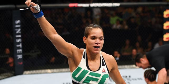 NASHVILLE, TN - AUGUST 08: (L-R) Amanda Nunes of Brazil celebrates after defeating Sara McMann in their women's bantamweight bout during the UFC Fight Night event at Bridgestone Arena on August 8, 2015 in Nashville, Tennessee. (Photo by Josh Hedges/Zuffa LLC/Zuffa LLC via Getty Images)