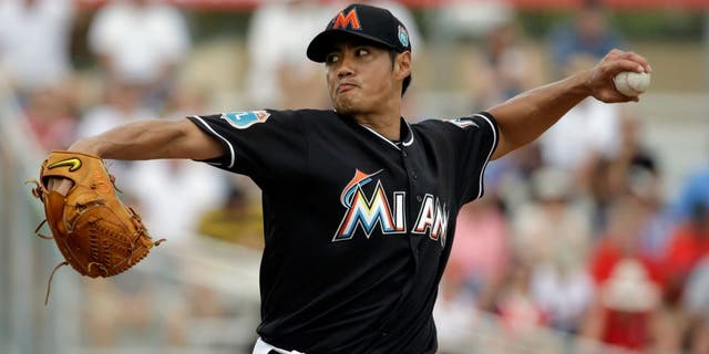 Miami Marlins starting pitcher Wei-Yin Chen throws during the first inning of an exhibition spring training baseball game against the St. Louis Cardinals Saturday, March 5, 2016, in Jupiter, Fla. (AP Photo/Jeff Roberson)