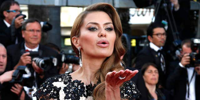 """May 16, 2014: Russian television host Victoria Bonya blows a kiss as she poses on the red carpet for the screening of the film """"How to Train Your Dragon 2"""" out of competition at the 67th Cannes Film Festival in Cannes."""