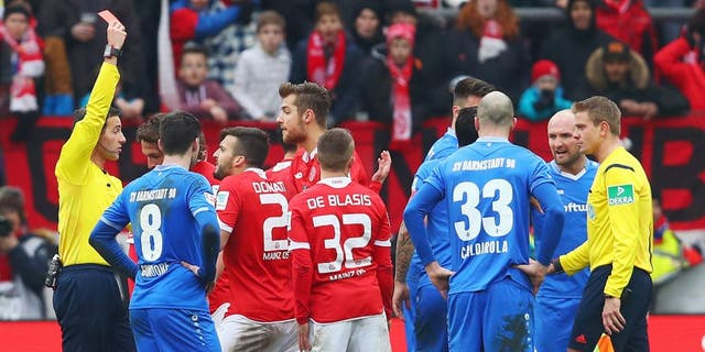 MAINZ, GERMANY - MARCH 06: Referee Benjamin Brand shows the red card to Giulio Donati of Mainz during the Bundesliga match between 1. FSV Mainz 05 and SV Darmstadt 98 at Coface Arena on March 6, 2016 in Mainz, Germany. (Photo by Alex Grimm/Bongarts/Getty Images)