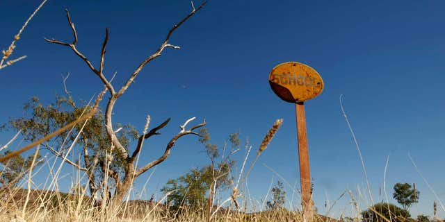 A rusting sign indicating where a school once operated stands in the former town of Wittenoom, about 870 miles north of the West Australian city of Perth.