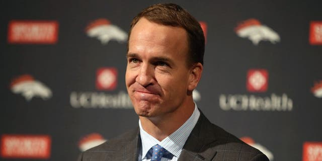 ENGLEWOOD, CO - MARCH 07: Quarterback Peyton Manning reacts as he announces his retirement from the NFL at the UCHealth Training Center on March 7, 2016 in Englewood, Colorado. Manning, who played for both the Indianapolis Colts and Denver Broncos in a career which spanned 18 years, is the NFL's all-time leader in passing touchdowns (539), passing yards (71,940) and tied for regular season QB wins (186). Manning played his final game last month as the winning quarterback in Super Bowl 50 in which the Broncos defeated the Carolina Panthers, earning Manning his second Super Bowl title. (Photo by Doug Pensinger/Getty Images)